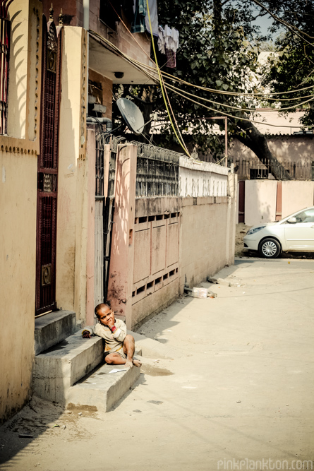 a residential street in New Delhi with child