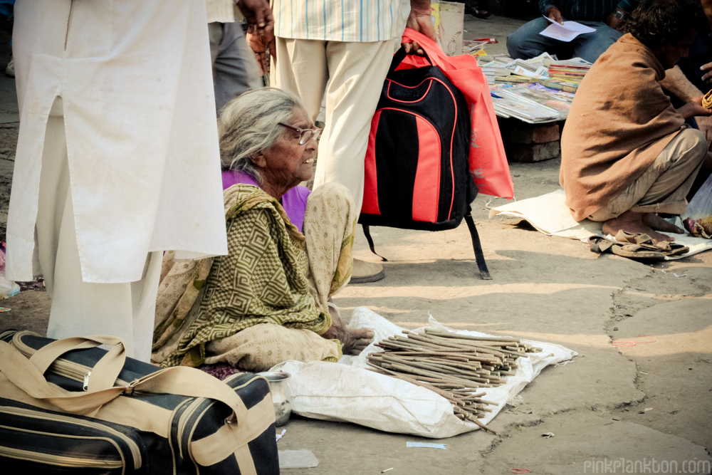 Indian woman selling toothbrushes on street in New Delhi