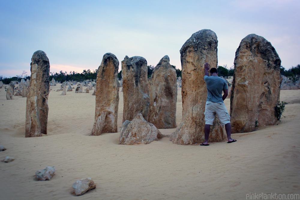 Man peeing in the Pinnacle Dessert, Western Australia
