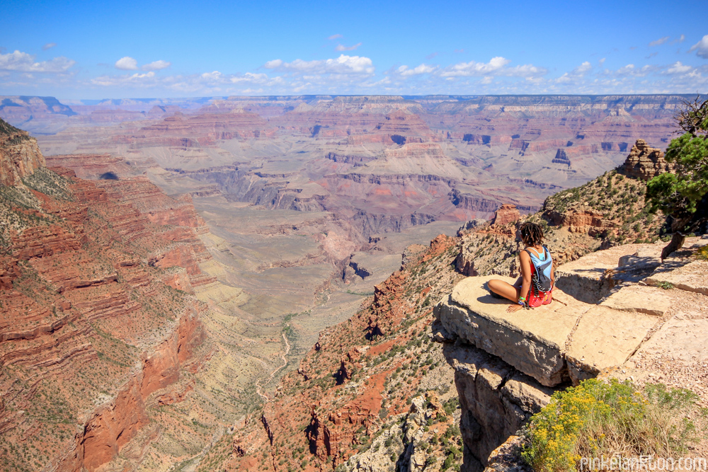 Girl sitting on edge of the Grand Canyon in Arizona