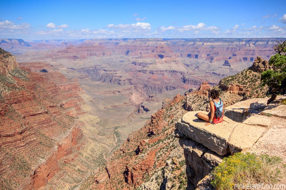 Girl sitting on edge of the Grand Canyon in Arizona