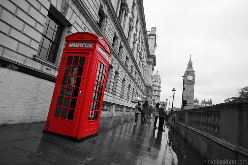 red phone booth in London with Big Ben in background