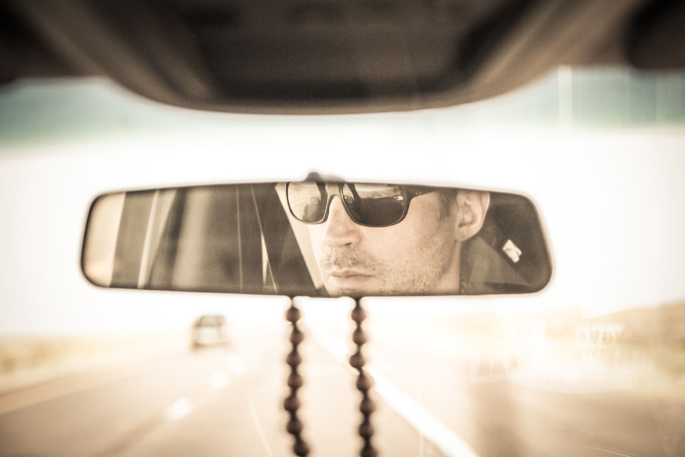 man driving in rear view mirror