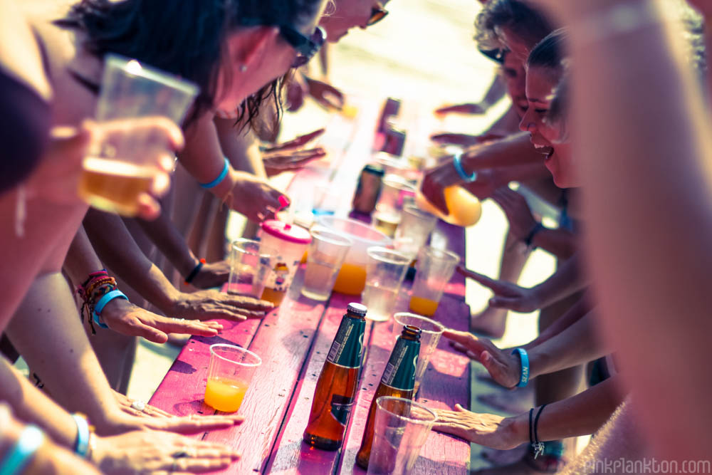 playing flip cup on the beach