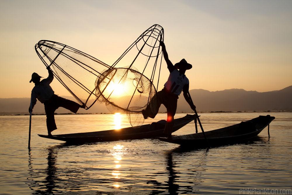 fisherman posing at sunset on Inle Lake