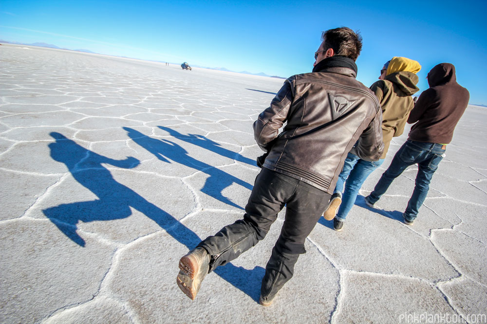 people making shadows on the Salar de Uyuni in Bolivia
