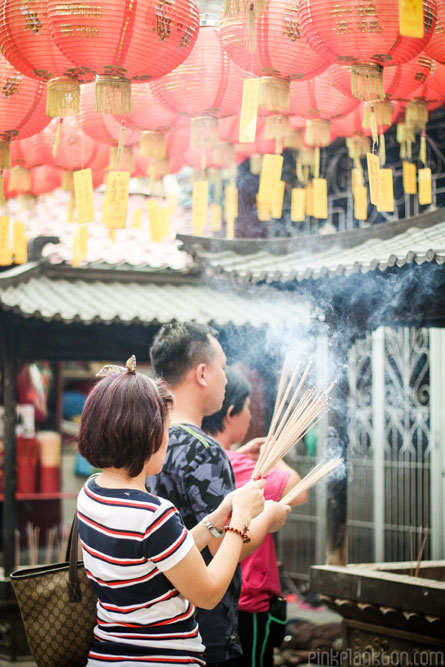 Chinese New Year people burning insence in temple