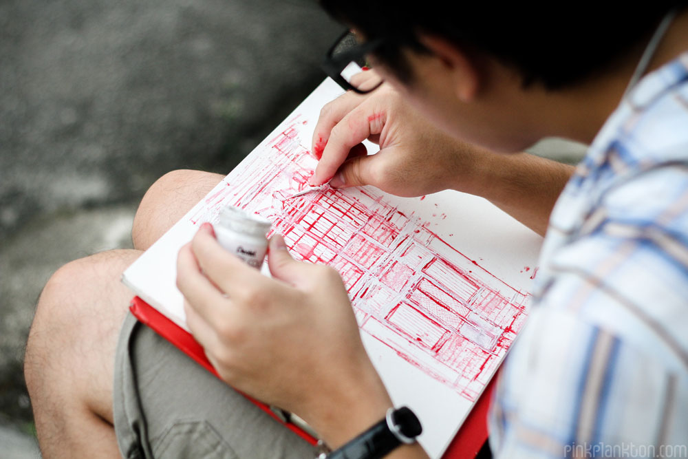 young man sketching colonial architecture of Georgetown, Malaysia