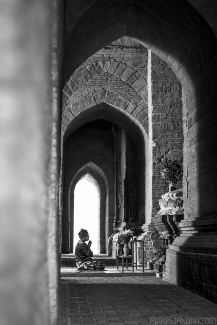 Burmese lady praying in temple in Bagan