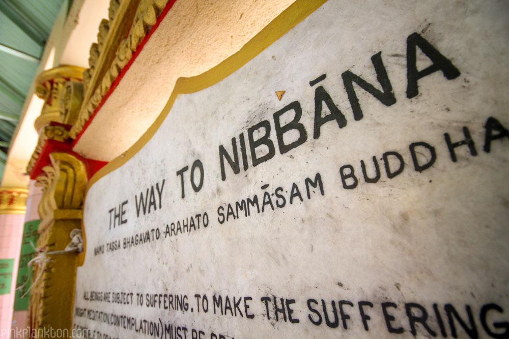 way to Nirvana sign in temple in Myanmar