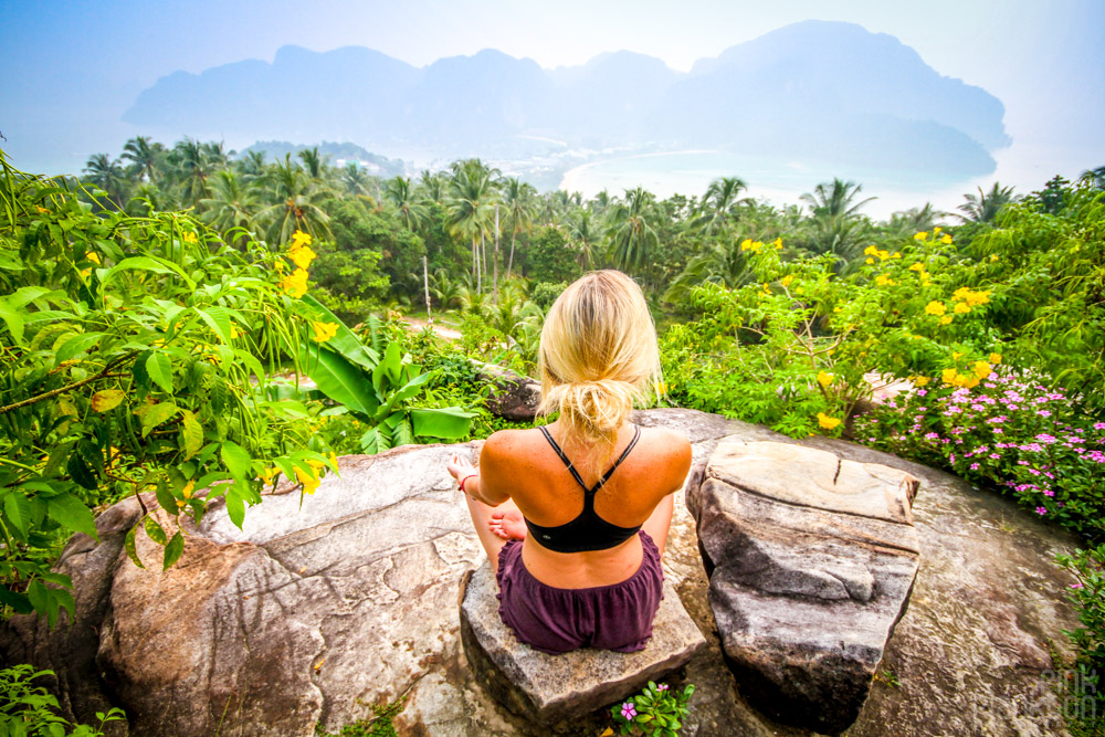 girl meditating at Phi Phi lookout in Thailand