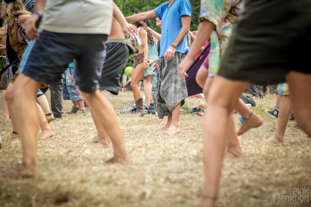 people's legs dancing on dancefloor