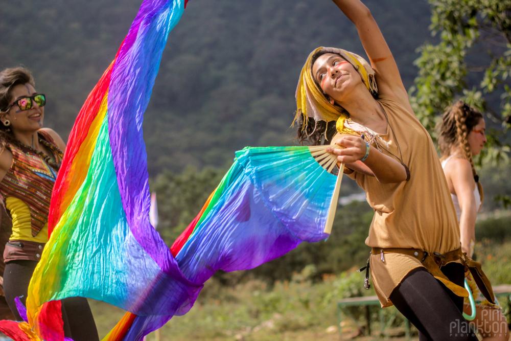 girl waving rainbow flags