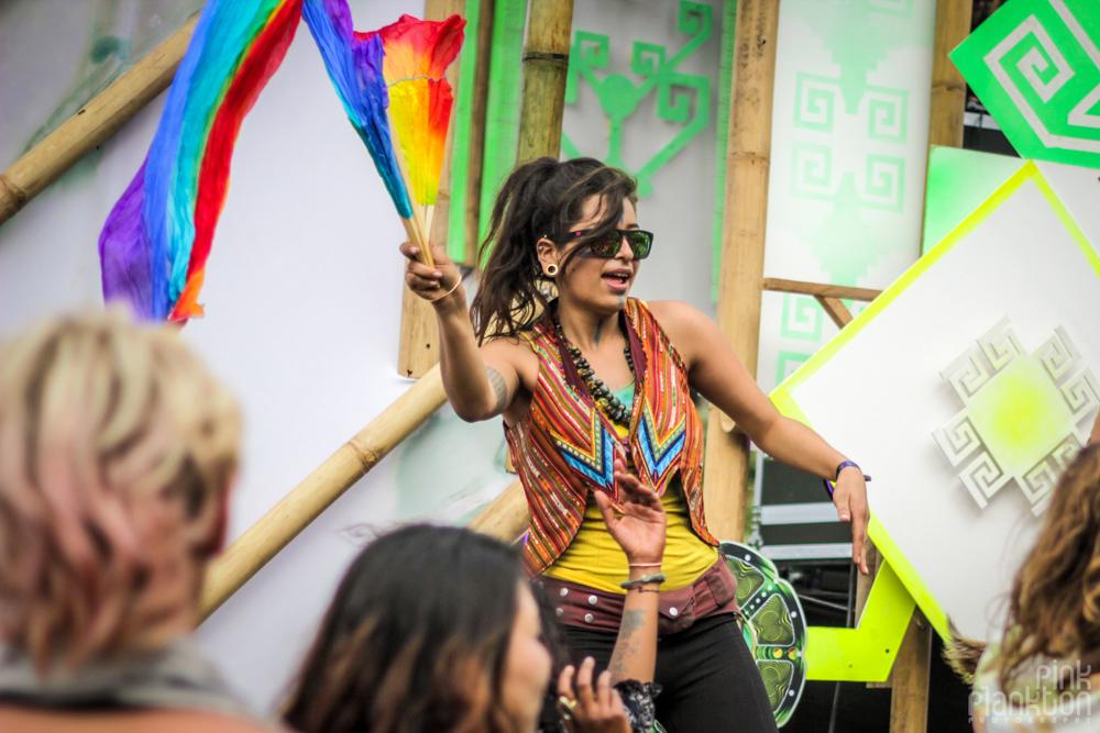 girl waving flag at Cosmic Convergence Festival