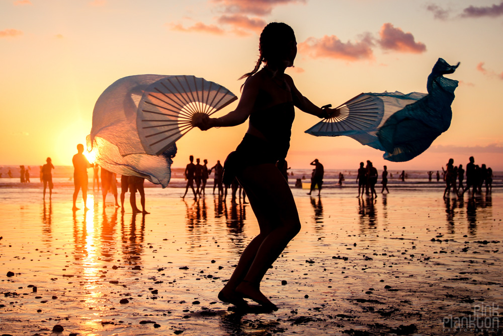 Envision Festival beach at sunset with silk fan dancer