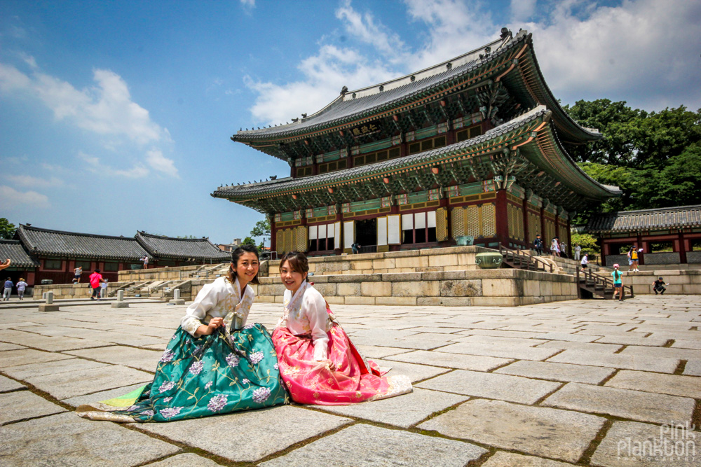 Changdeokgung temple girls in hanboks posing in South Korea