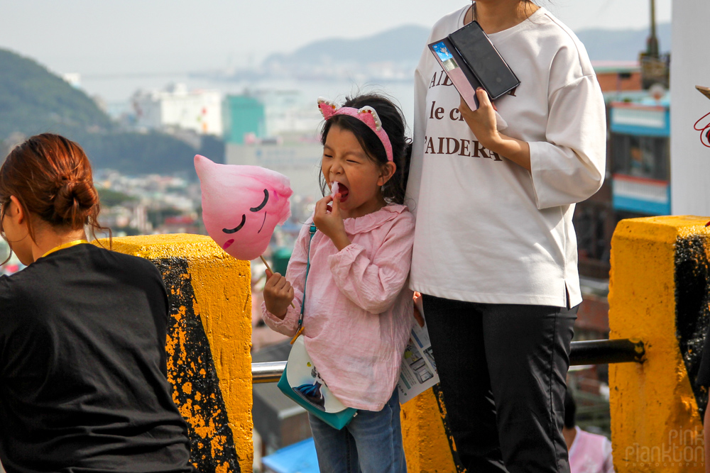 child eating cotton candy with face in Korea