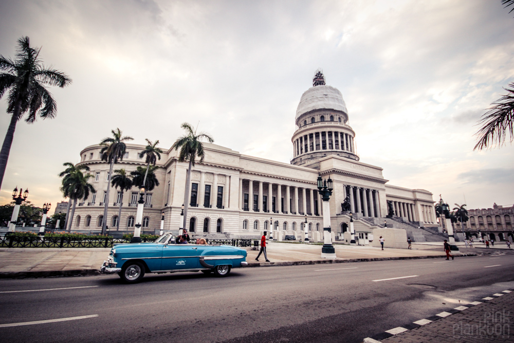 El Capitolio and blue classic car in Havana Cuba