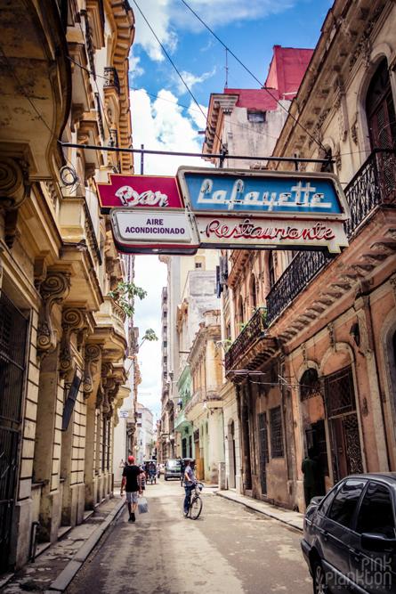 Havana, Cuba grungy street with old neon sign