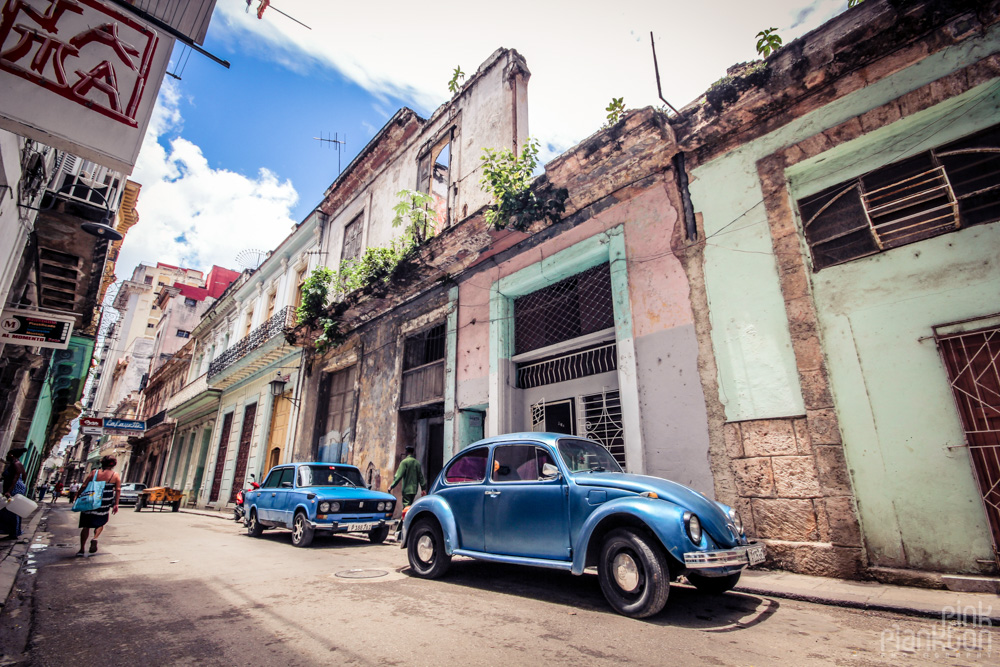 grungy streeet with beetle car in Havana Cuba