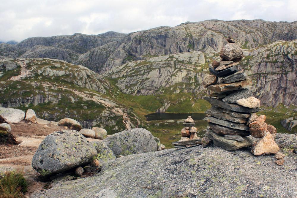 Rock piles on scenery on hike to Kjeragbolten in Norway