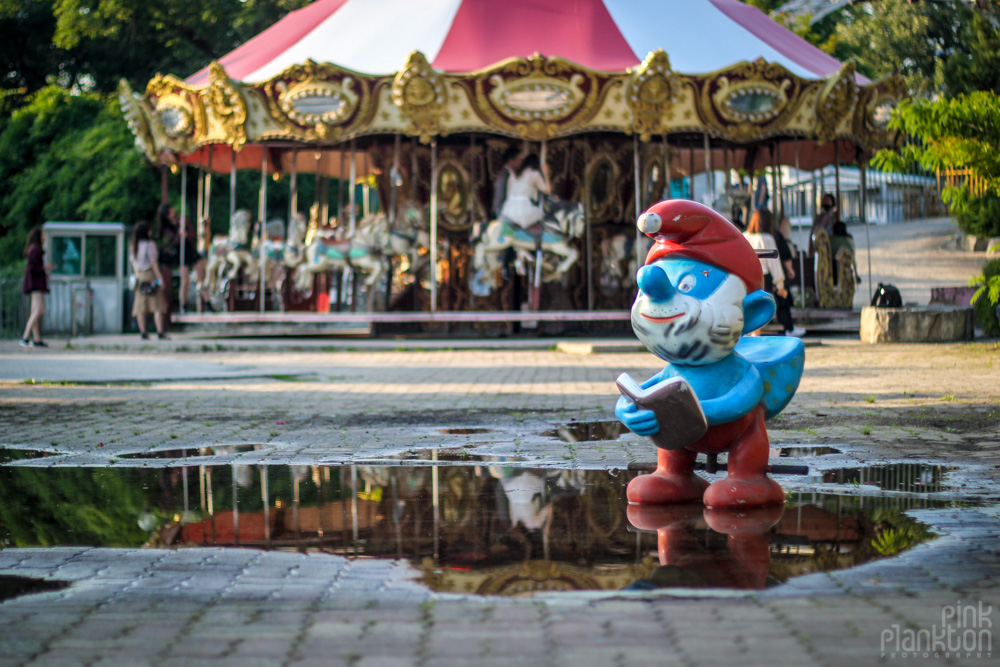 abandoned merry go round and smurf statue at Yongma Land in Seoul