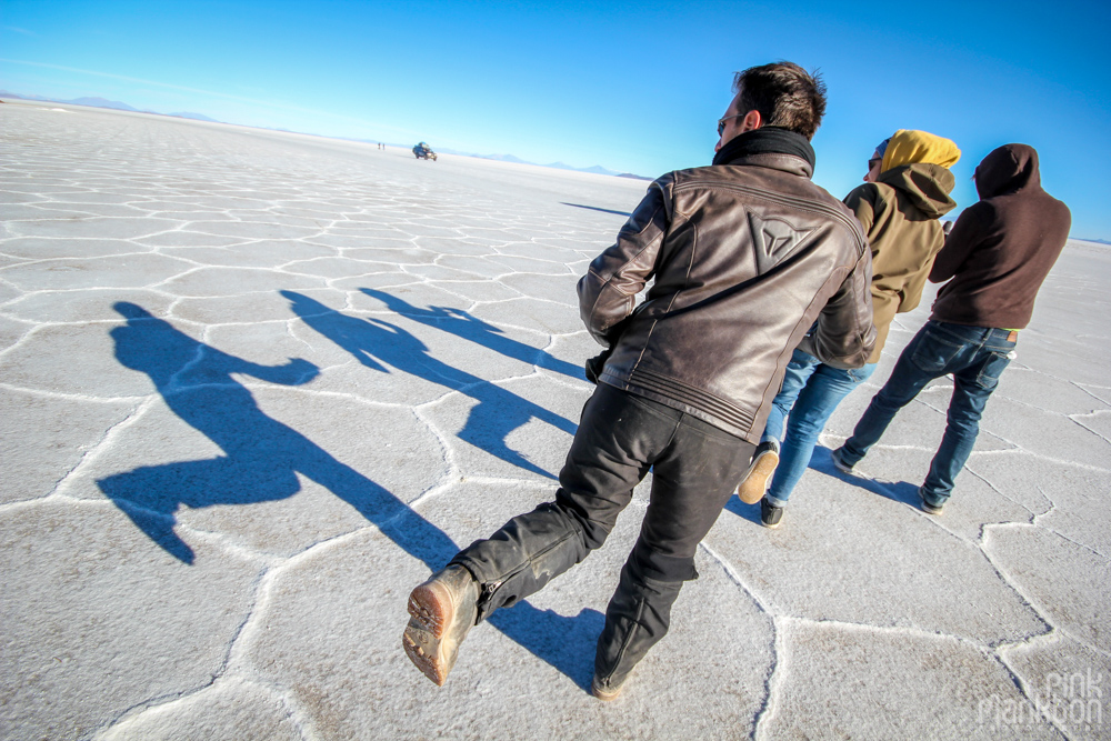 people and their shadows on Bolivia's Salar de Uyuni