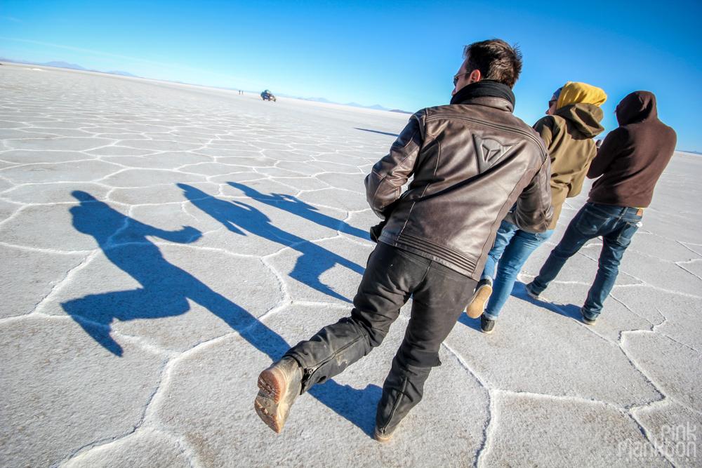 people and their shadows on Bolivia's Salar de Uyuni