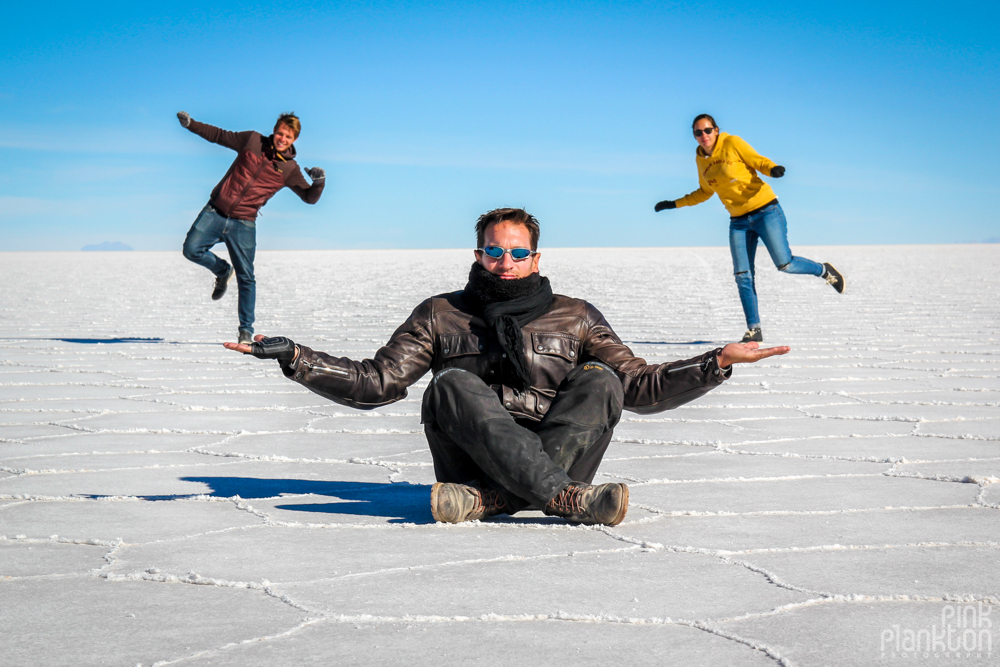 perspective photo of person holding other people on Bolivia's Salar de Uyuni