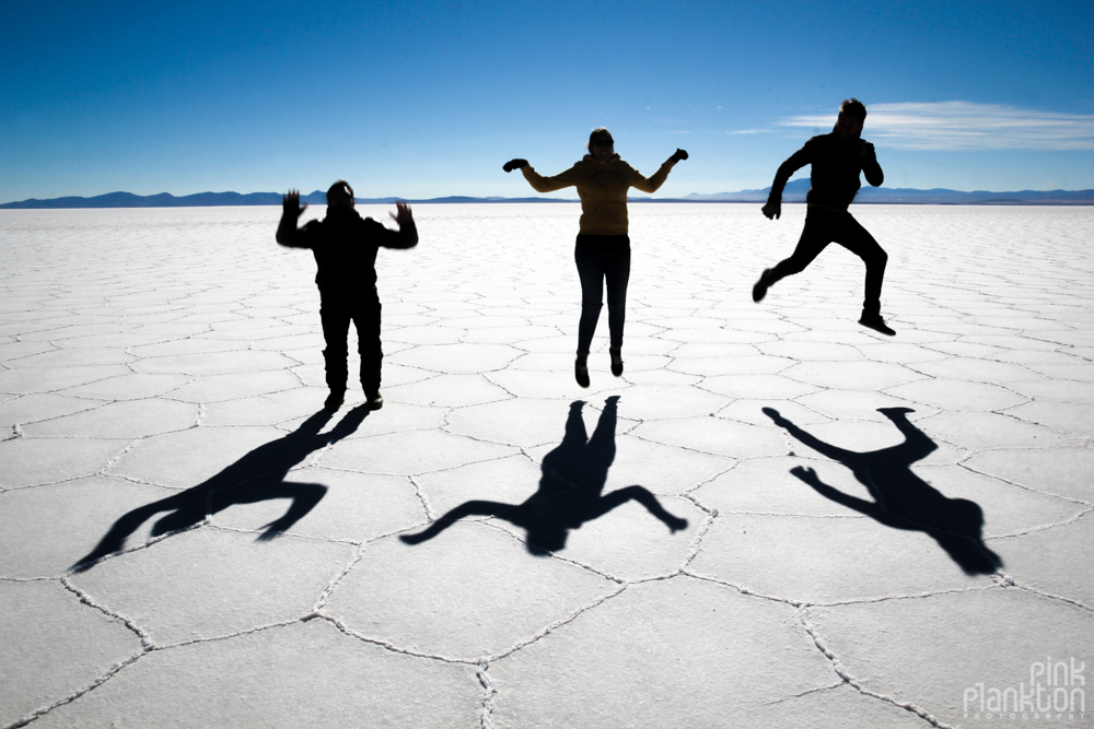 shadows and silhouettes of people on Bolivia's Salar de Uyuni