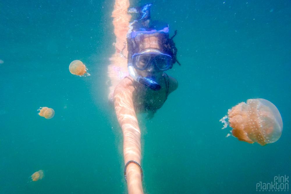 girl snorkeling in jellyfish lake in Togean Islands, Sulawesi, Indonesia
