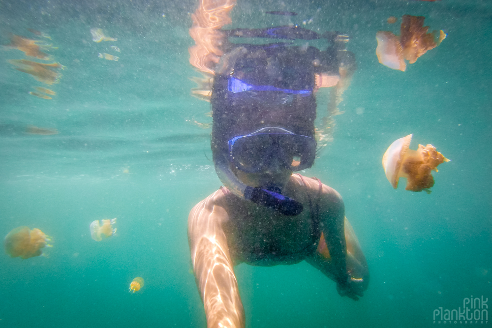 girl snorkeling in jellyfish lake in Togean Islands, Sulawesi, Indonesia