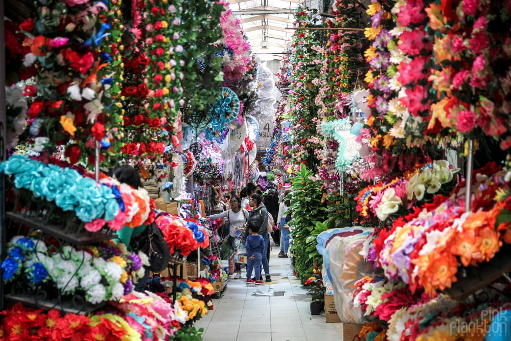 artificial flower aisle and party decorations in Mexico City's Mercado de Flores Merced