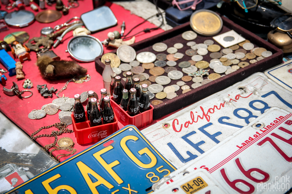 antique license plates, coins, and coke bottles in Mercado La Lagunilla in Mexico City