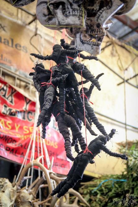 voodoo dolls in Mercado Sonara Witch Market in Mexico City
