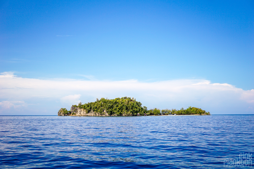 island of Fadhila Cottages in the Togean Islands from afar