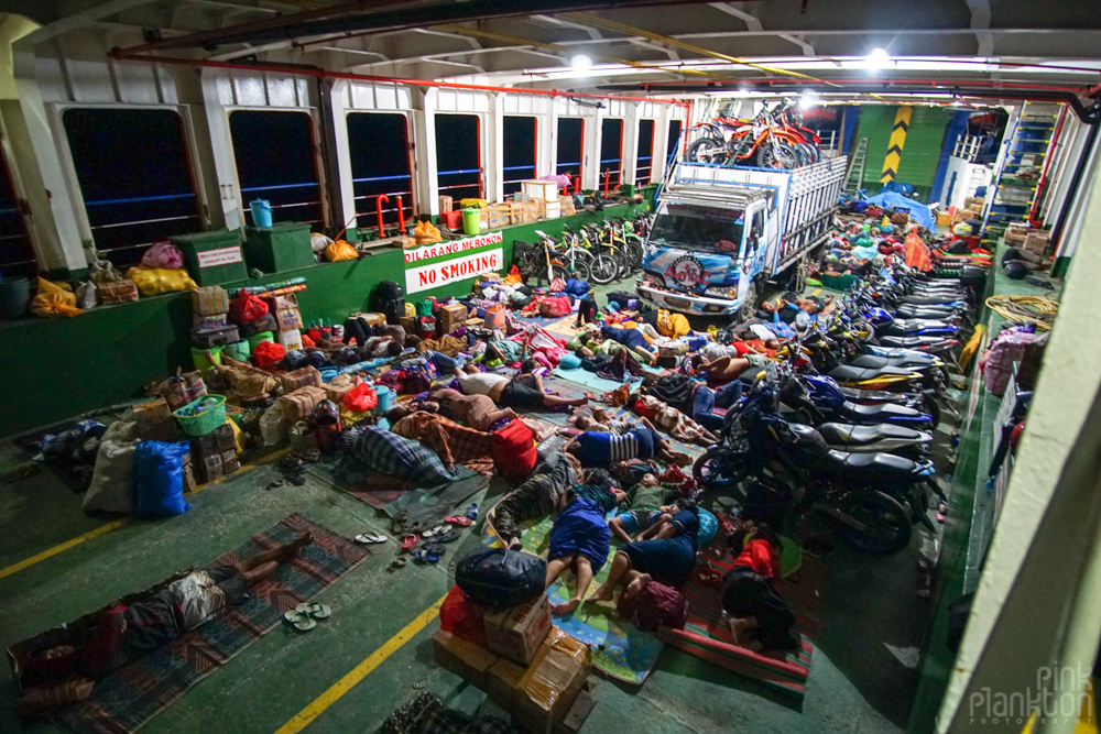 passengers in cargo area of overnight ferry from Togean Islands to Gorontalo