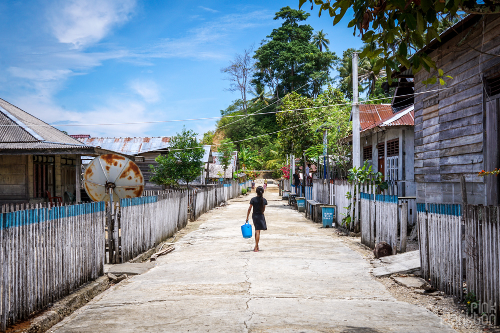 girl walking in Katupat village, Togean Islands
