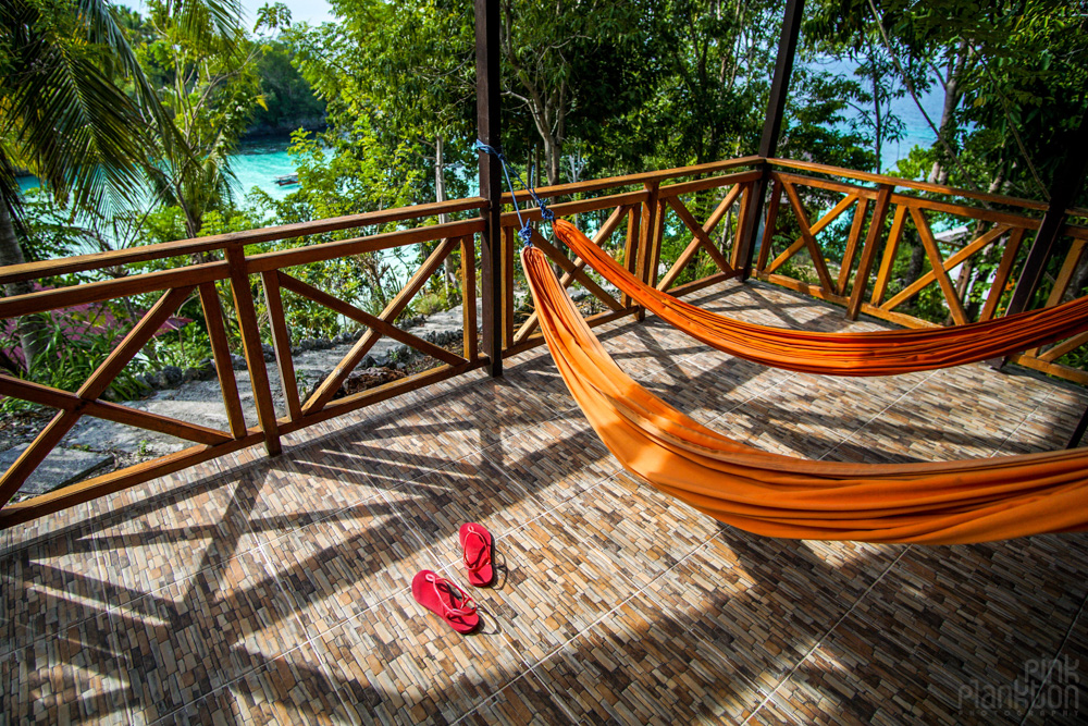 hammocks and bungalow in the hill of Sera Beach in the Togean Islands