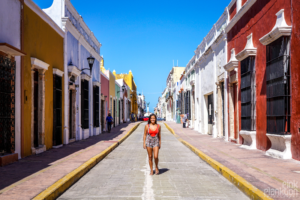 woman walking down colorful streets of Campeche