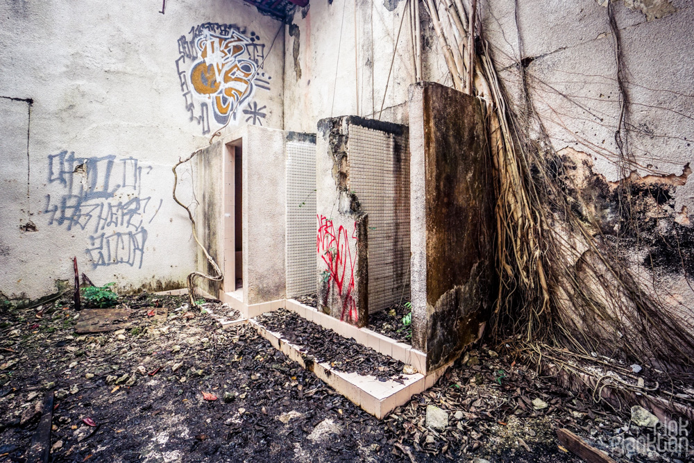 inside an abandoned building in Minsebalam ghost town
