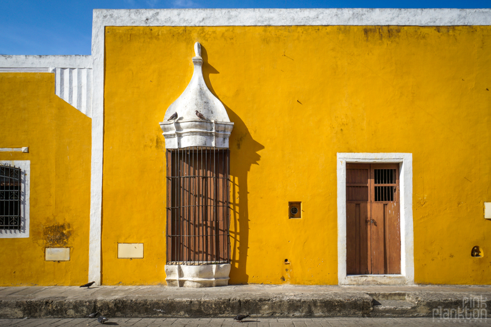 yellow buildings on the streets of Izamal, Mexico