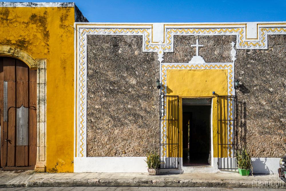 yellow doorway with cross in Izamal, Mexico