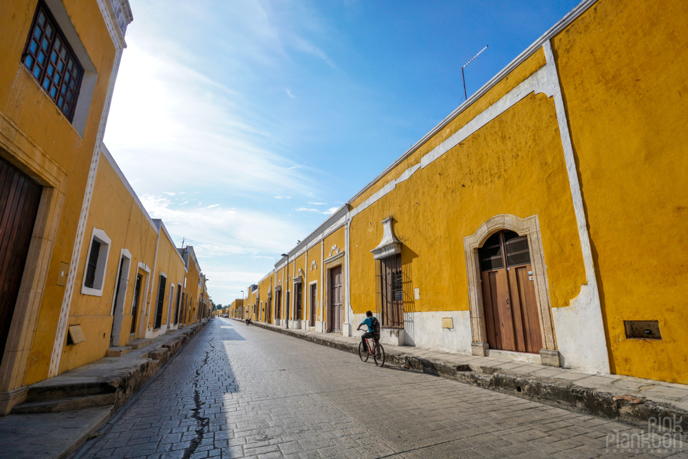 a street lined with yellow buildings in Izamal, Mexico