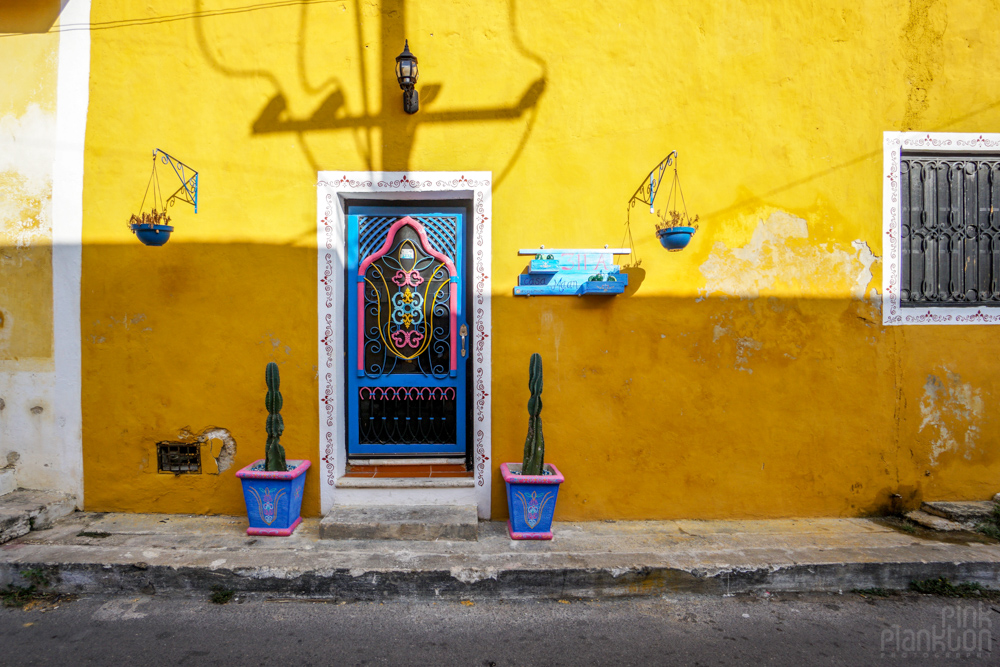 colorful doorway on yellow wall in Izamal Mexico
