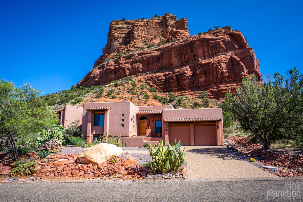 House in Sedona with red rocks in backyard